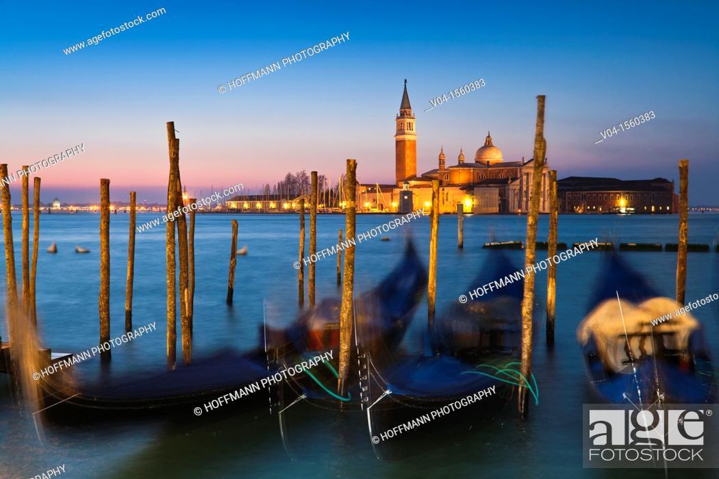Imagen: Sunrise over San Giorgio Maggiore with gondolas in the foreground, Venice, Italy, Europe.