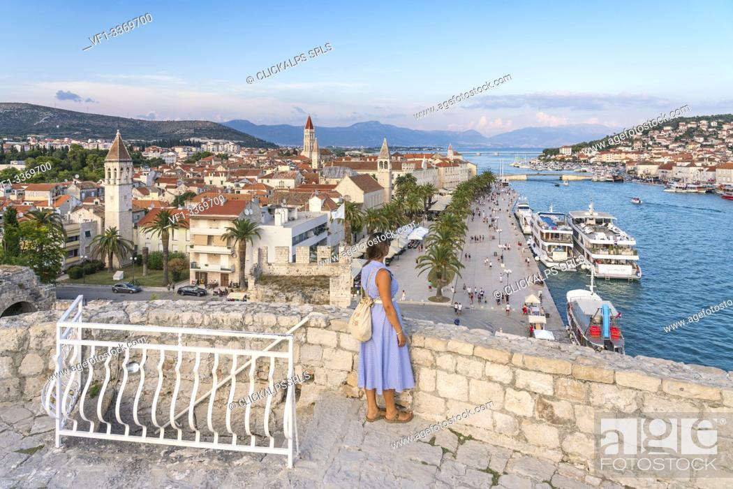 Stock Photo: Woman admiring the old town and seafront from Karmelengo castle, in summer. Trogir, Split - Dalmatia county, Croatia.