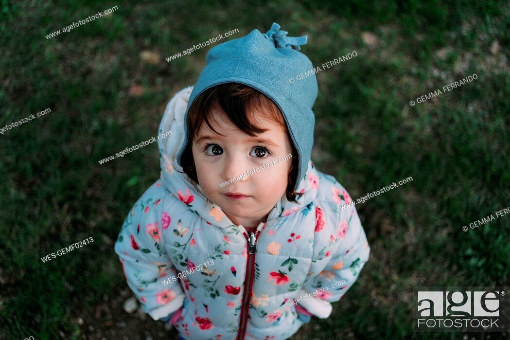 Stock Photo: Portrait of fashionable little girl standing on a meadow in autumn.