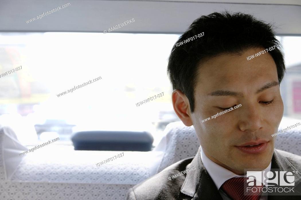 Stock Photo: Businessman in car, portrait.