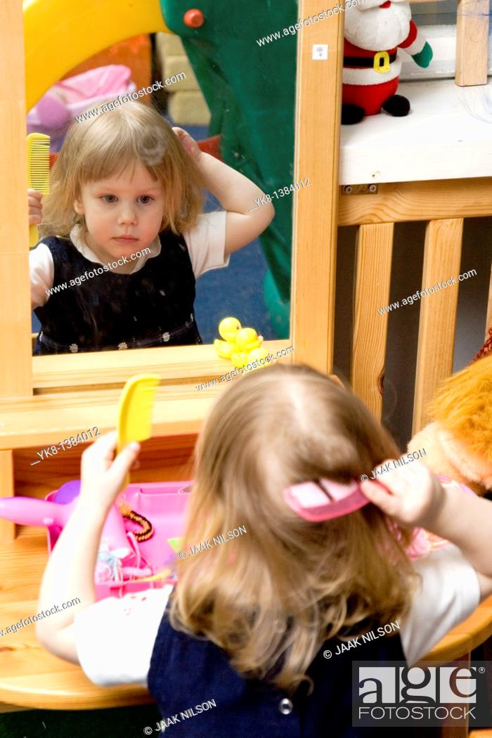 Stock Photo: Two Year Old Kid Girl Combing Hair Looking Mirror.