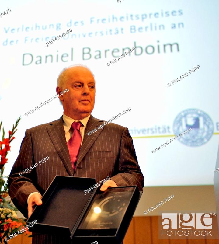 Stock Photo: Daniel Barenboim stands in front of the stage and shows the Freedom Award he just received from the Freie Universitaet Berlin in the Henry Ford Building of the.