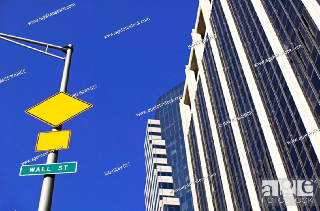 Stock Photo: Road signs and buildings on Wall Street.