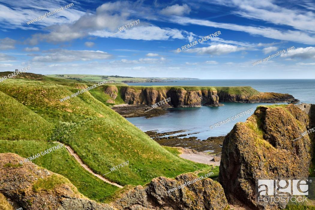Stock Photo: Stonehaven War Memorial on Black Hill with Castle Haven Bay and steps down to the Donnottar Castle ruins entrance Scotland UK.