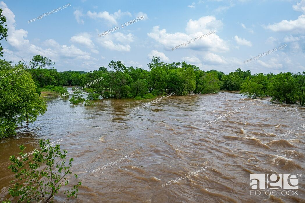 Stock Photo: Shoal Creek flooding in Joplin, Missouri on May 23, 2019 from Redings Mill Bridge.