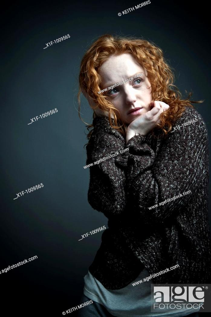 Stock Photo: sad red haired woman girl.
