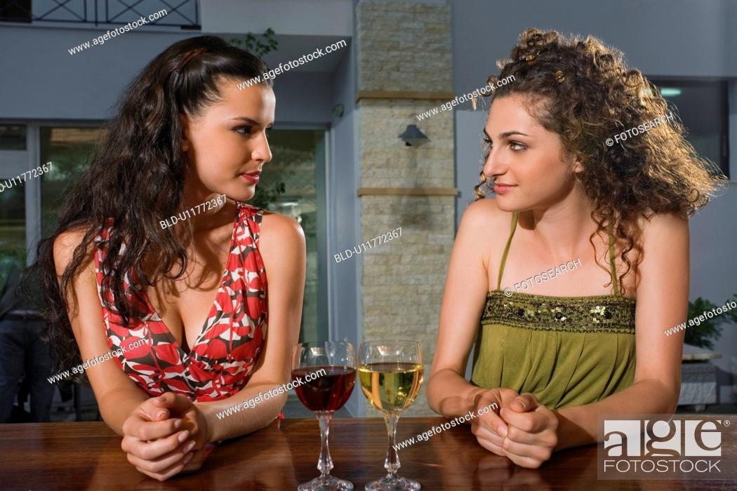 Stock Photo: Two women in a bar.