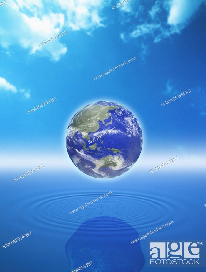 Stock Photo: Digital composite of globe over water.