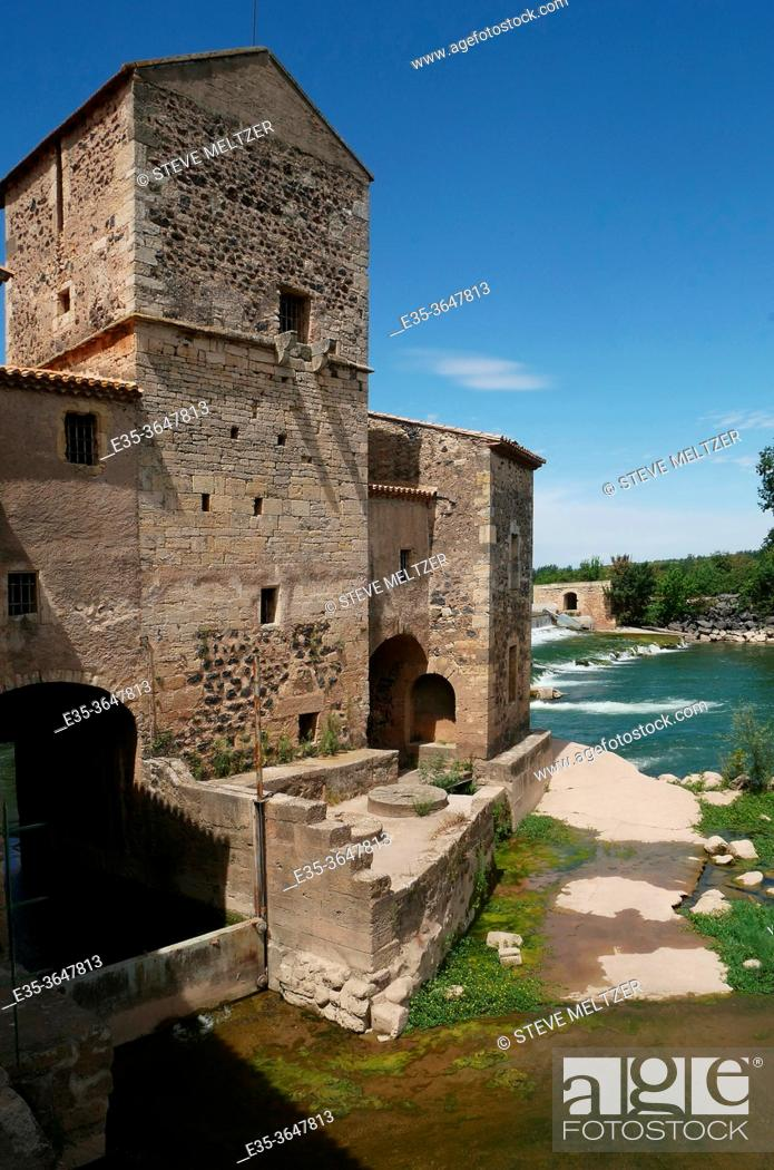 Stock Photo: A medieval grain - corn and wheat- mill on the Herault river at St. Thibery, France.