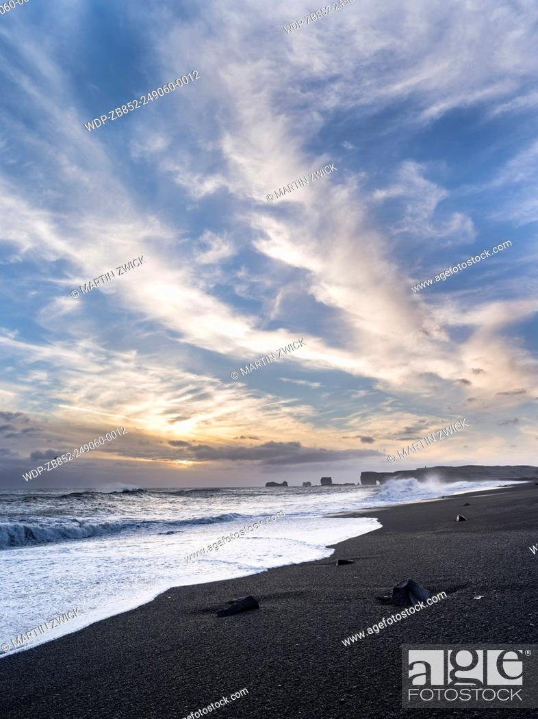 Stock Photo: Coast of the North Atlantic near Vik y Myrdal during winter, view towards the stacks and sea arch at cape Dyrholaey. europe, northern europe, scandinavia.