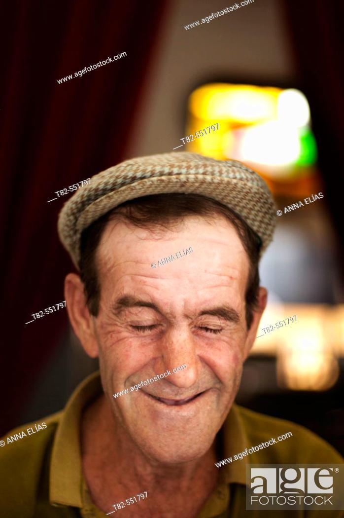 Stock Photo: Old man in a local bar. Cazalla de la Sierra, Sevilla province. Andalucia. Spain.