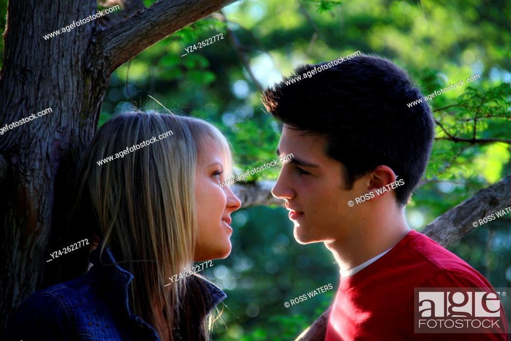Stock Photo: Closeup of a young couple outdoors.