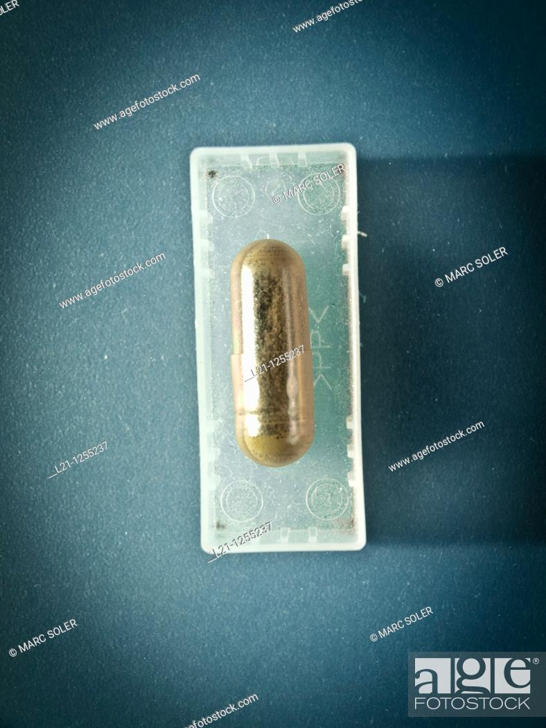 Stock Photo: Herbal pill in a small plastic box.
