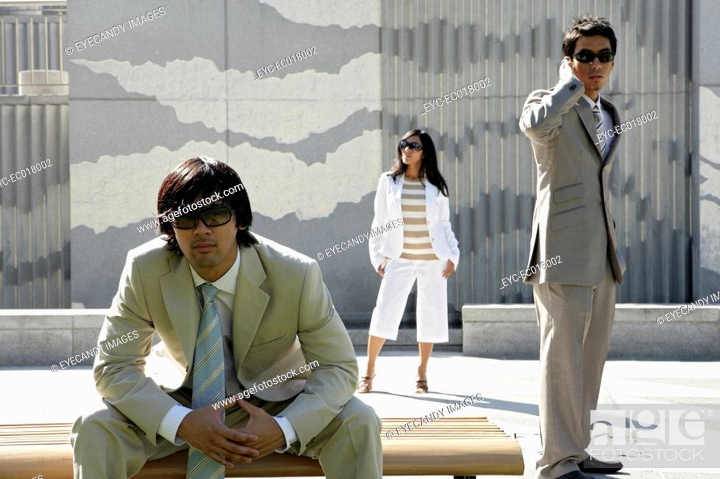 Stock Photo: View of three colleagues in an office attire.