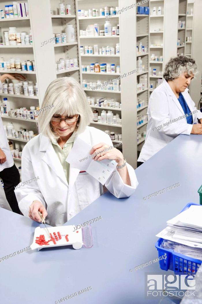 Stock Photo: Pharmacists filling prescriptions.
