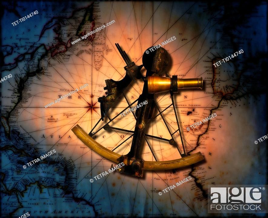Historic sextant with old world map in background stock photo stock photo historic sextant with old world map in background gumiabroncs Choice Image