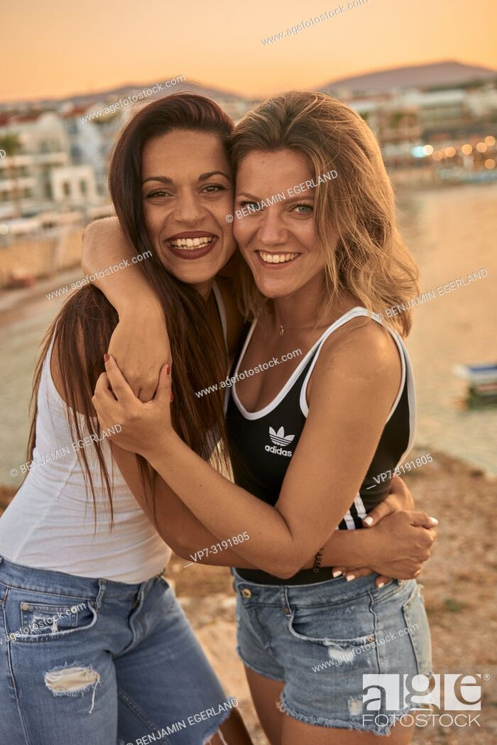 Stock Photo: portrait of two women, embracing, friends, smiling, in Chersonissos, Crete, Greece.