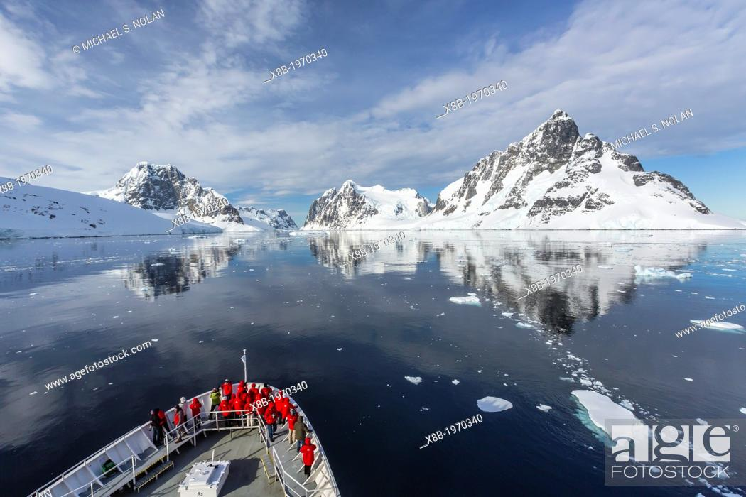 Stock Photo: The Lindblad Expedition ship National Geographic Explorer on expedition in the Lemaire Channel in Antarctica, Southern Ocean.