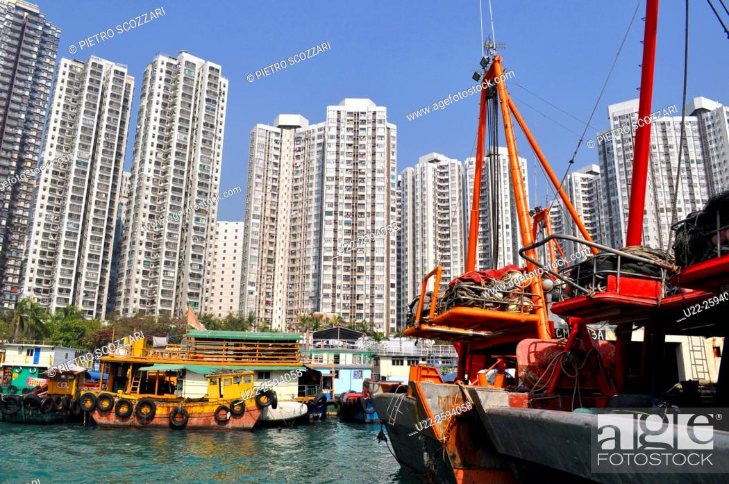 Stock Photo: Hong Kong: boats and apartment buildings in Abardeen.