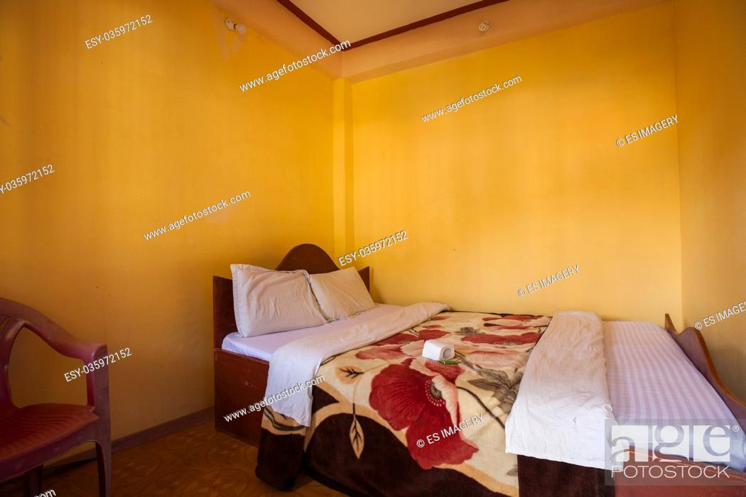 Stock Photo: Double bed hotel room in Nepal, a major backpacking destination.