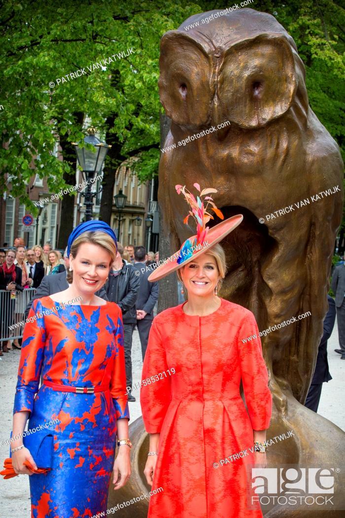 Belgian Queen Mathilde (L) and Dutch Queen Maxima attend the