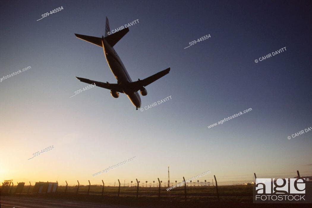 Stock Photo: CSA airbus A320 landing at Dublin airport on runway 34 at sunset.