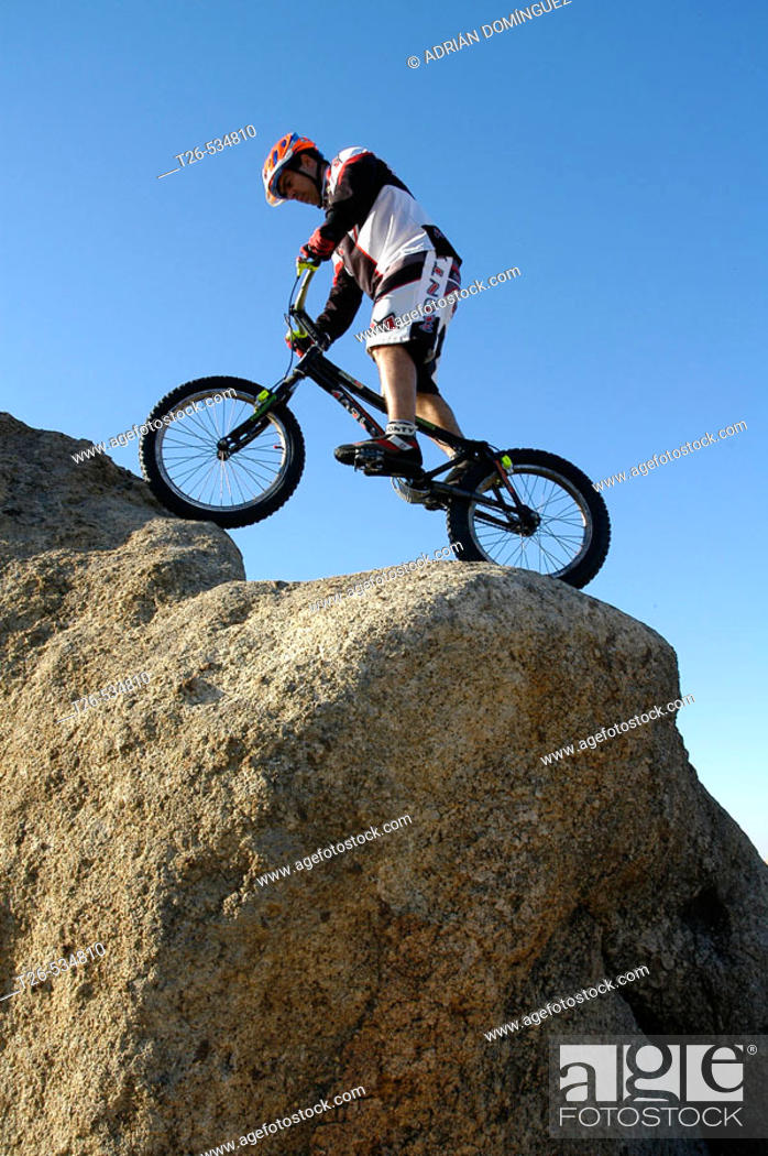 Stock Photo: Man doing bike trial on rocks.