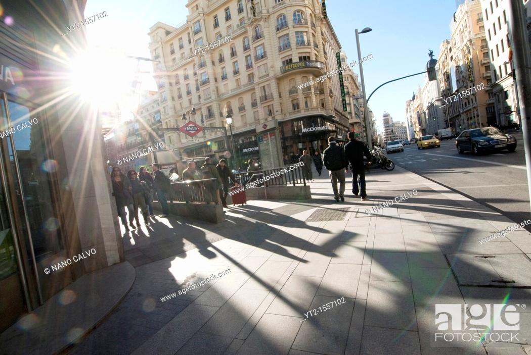 Stock Photo: Gran Via literally 'Great Way' is an ornate and upscale shopping street located in central Madrid  It leads from Calle de Alcala, close to Plaza de Cibeles.