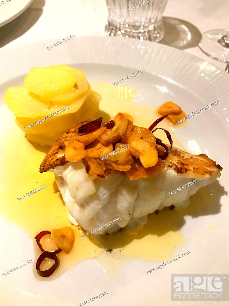 Stock Photo: Grilled monkfish with garlic and potatoes. Spain.