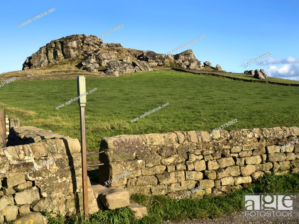 Stock Photo: Almscliff Crag millstone grit outcrop near Harrogate North Yorkshire England.