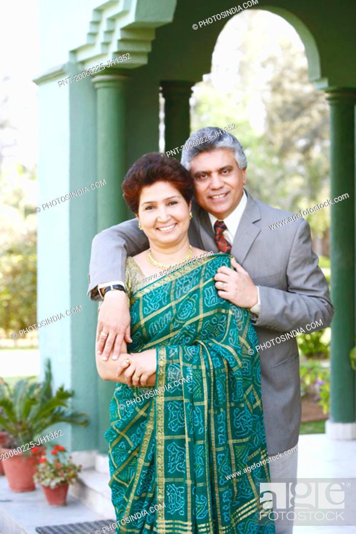 Stock Photo: Portrait of a mature couple smiling.