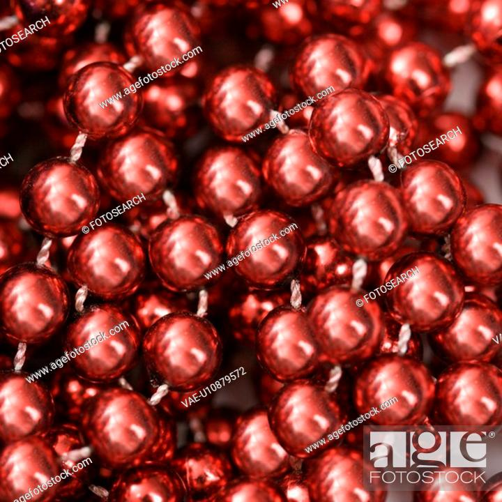 Stock Photo: Close up of strings of red beads.