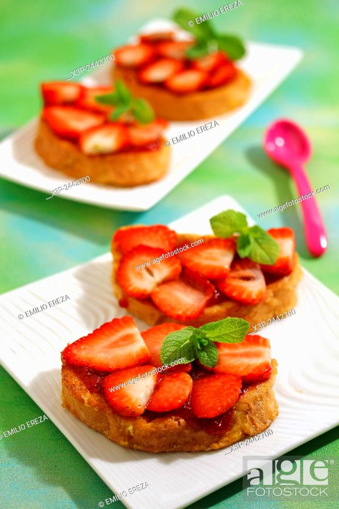 Stock Photo: Torrijas with strawberries. Typical Spanish meal.