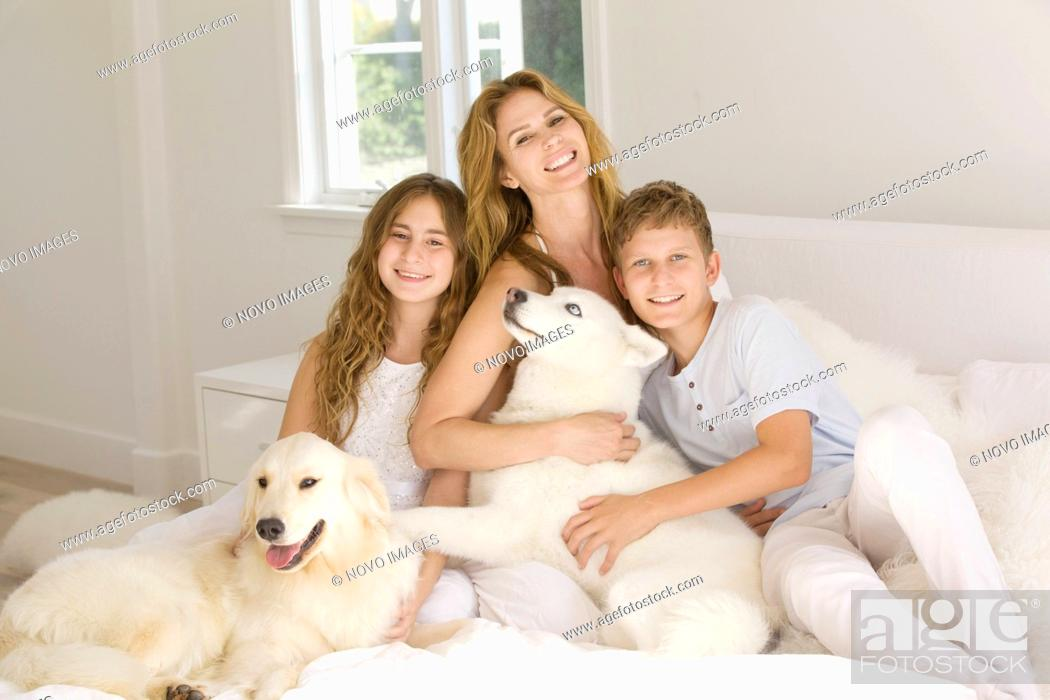 Imagen: Happy Family Portrait of Mother with Two Young Children and Pet Dogs II.