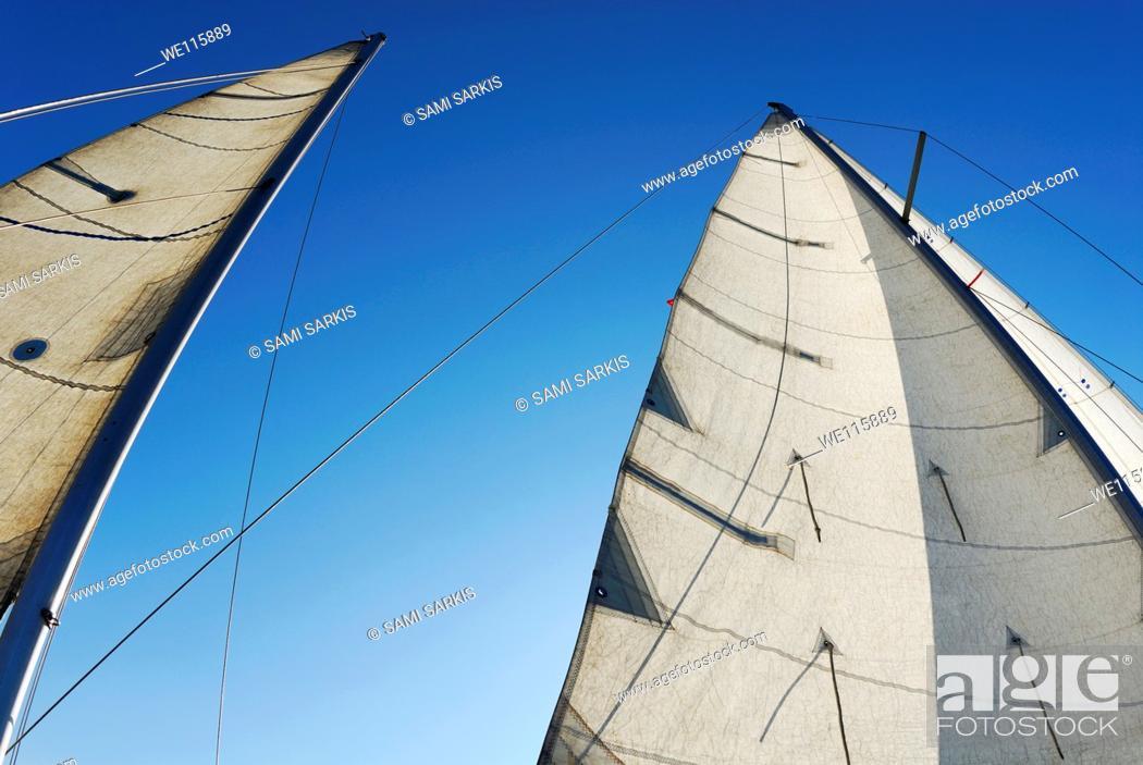 Stock Photo: Sails against blue sky, Marseille, France.