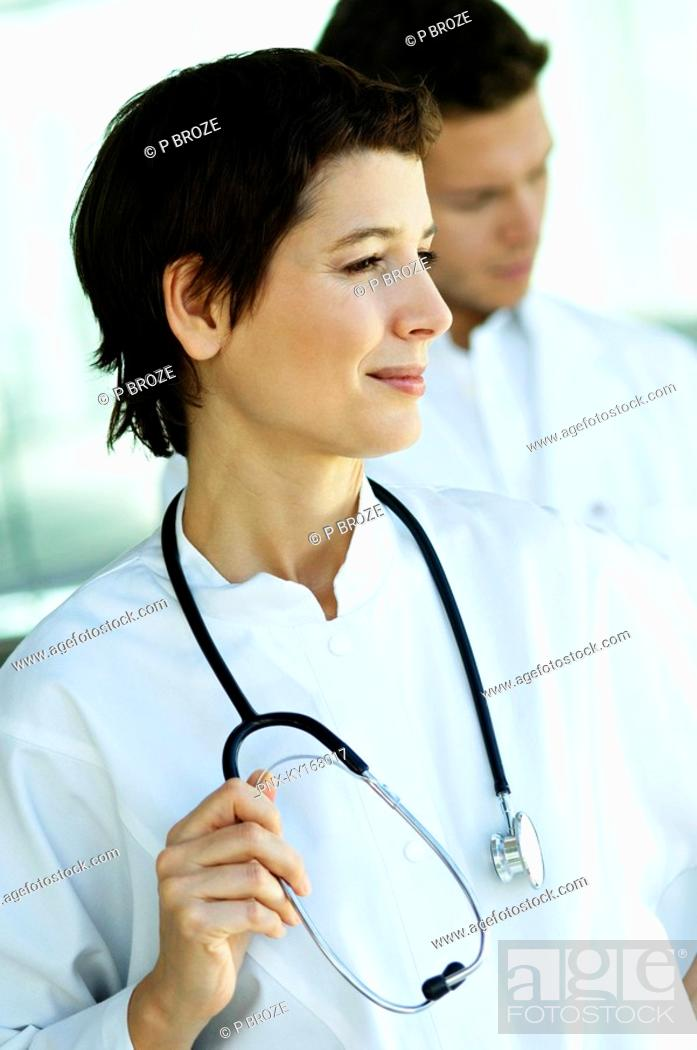 Stock Photo: Close-up of a female doctor standing with a stethoscope around her neck.