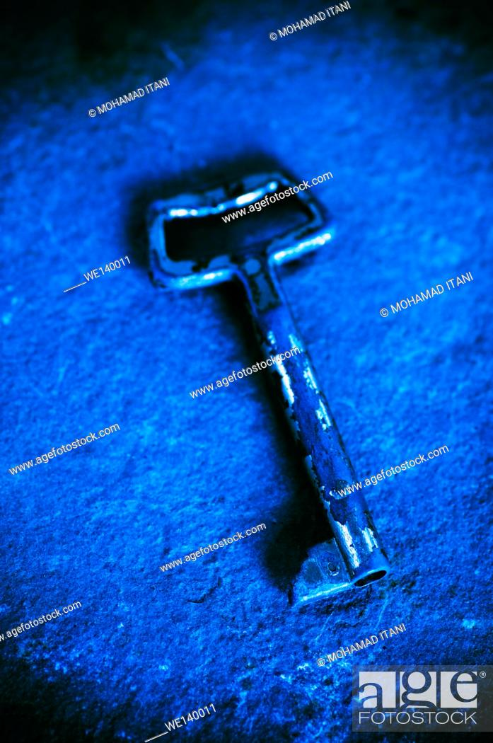 Stock Photo: Old metal key.