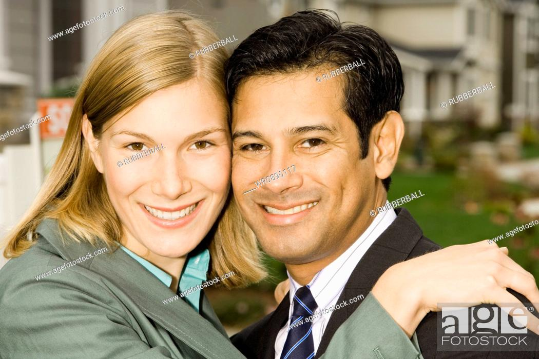 Stock Photo: Portrait of a businessman and a businesswoman smiling.