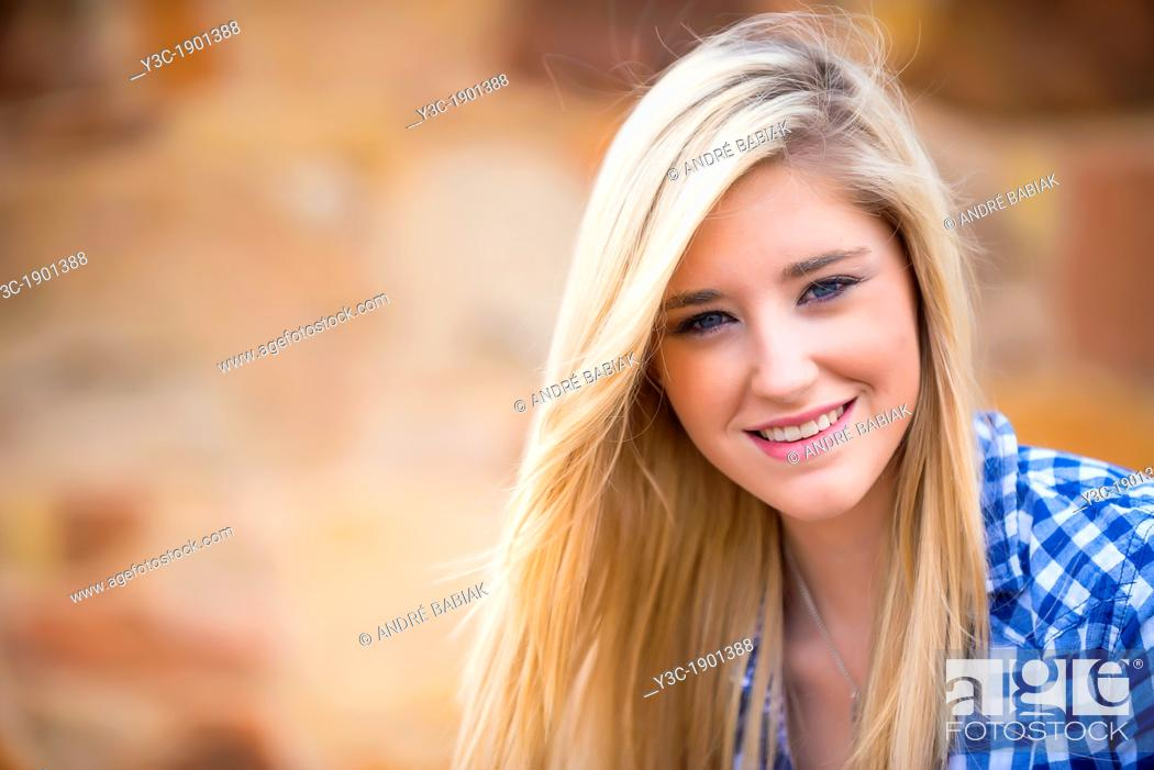 Stock Photo: Portrait of female Caucasian teenager with long blond hair.