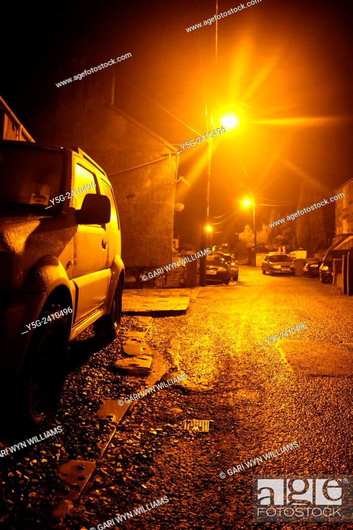 Stock Photo: Parked cars on empty street at night in clwt y bont wales great britain uk.
