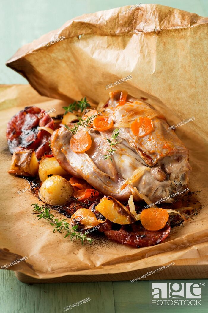 Stock Photo: Rabbit and vegetables cooked in wax paper.