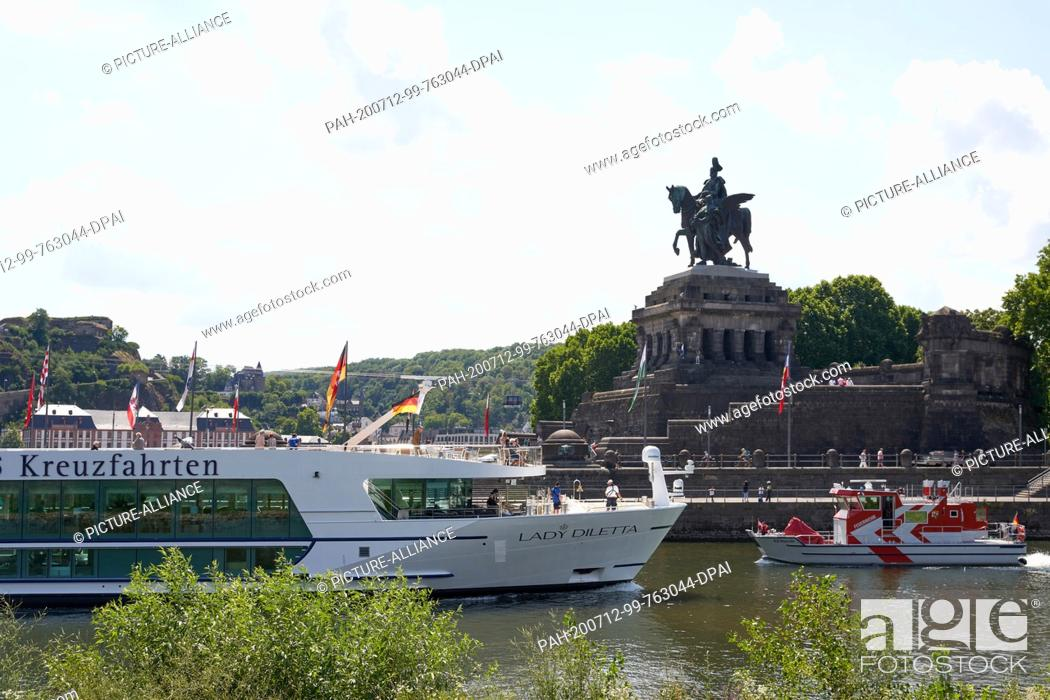 "Stock Photo: 12 July 2020, Rhineland-Palatinate, Koblenz: The river cruise ship """"Lady Diletta"""" turns into the mouth of the Moselle at Deutsches Ecks."