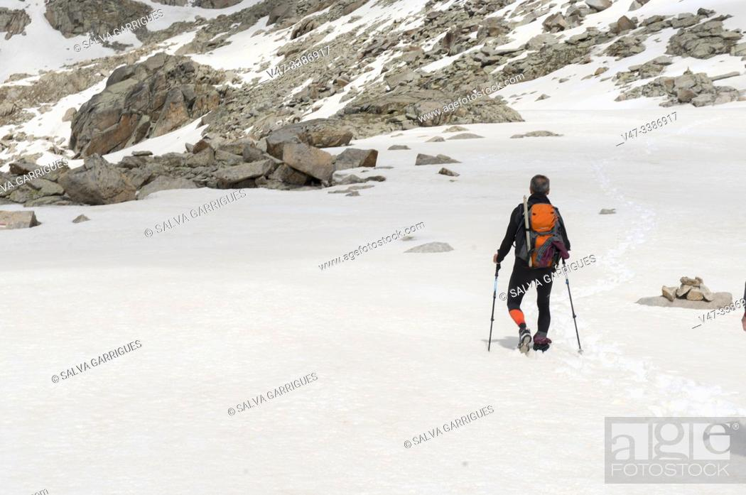 Stock Photo: Mountaineer ascending to the peak of Vallibierna, Huesca, Aragon, Spain.