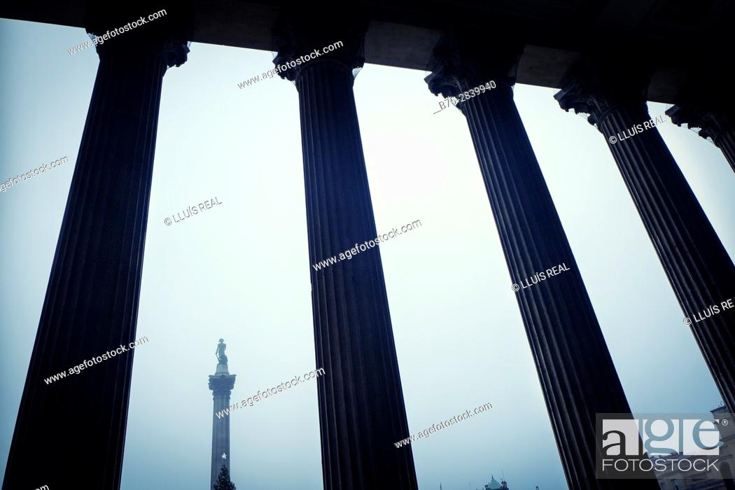 Stock Photo: Nelson's Column seen through the columns of the National Gallery, Trafalgar Square, London, England.