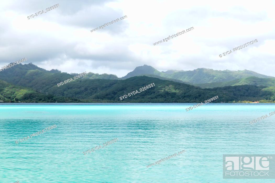 Stock Photo: lagoon and mountains in french polynesia.