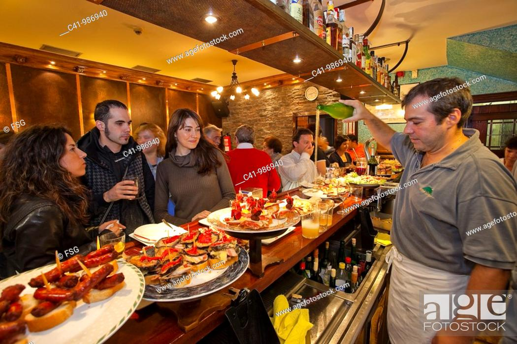 Stock Photo: Serving 'txakoli' basque wine, Bar Sport, San Sebastian, Guipuzcoa, Basque Country, Spain.