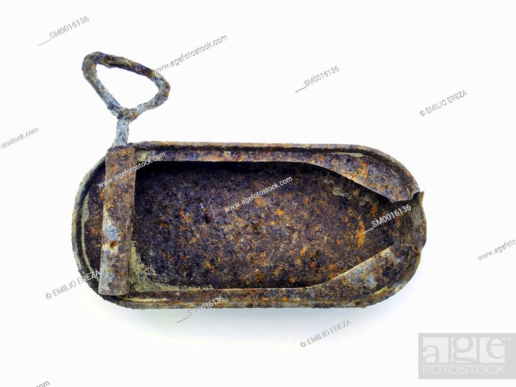Stock Photo: Rusted can.