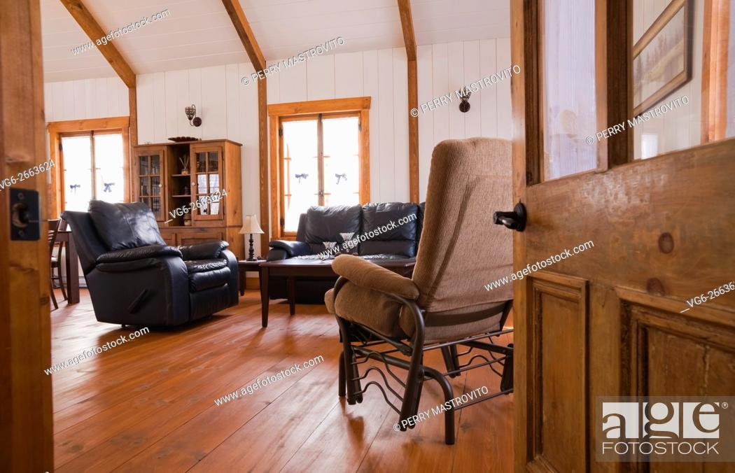 Living room inside the extension of a Canadiana cottage ...