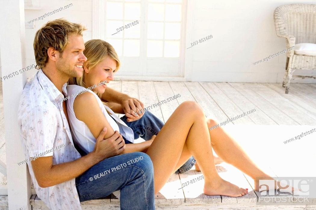 Stock Photo: Young couple happy sitting on the floor.