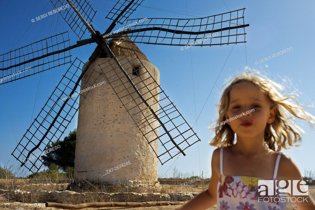 Stock Photo: Funy girl in the windmill, Formentera, Balearic Islands, Spain. Old Windmill in el Pilar de la Mola on the island Formentera, Balearic Islands, Spain.
